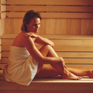 Panel-Built-Sauna-Woman-Relaxing-296x300-1